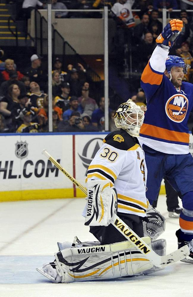 New York Islanders' Thomas Vanek (26) celebrates Andrew MacDonald's goal against Boston Bruins goalie Chad Johnson (30) as Matt Bartkowski (43) reacts in the second period of an NHL hockey game at the Nassau Coliseum on Saturday, Nov. 2, 2013, in Uniondale, N.Y. Vanek also scored in the second period