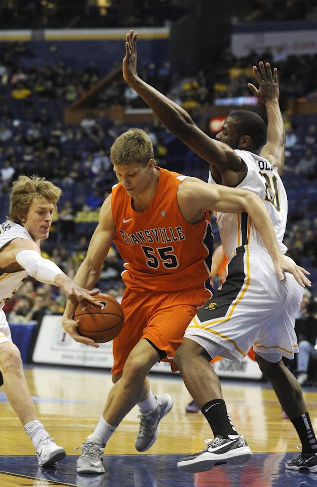 Evansville's Egidijus Mockevicius (55) drives through Wichita State's Ron Baker left, and  Kadeem Coleby, in the first half of an NCAA college basketball game in the quarterfinals of the Missouri Valley Conference  Friday, March 7, 2014  in St. Louis