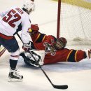 Florida Panthers goalie Tim Thomas (34) sprawls as he blocks a shot by Washington Capitals' Mike Green (52) during the third period of an NHL hockey game, Thursday, Feb. 27, 2014, in Sunrise, Fla. The Capitals won 5-4 The Associated Press