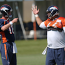 Denver Broncos quarterback Peyton Manning, left, confers with center Manny Ramirez during a morning session at the team's NFL football training camp in Englewood, Colo., on Friday, July 25, 2014. (AP Photo) The Associated Press