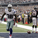 Dallas Cowboys' Dez Bryant (88) runs across the end zone celebrating after grabbing a pass for a touchdown as Houston Texans defensive back Andre Hal (29) argues the call with head linesman Dana McKenzie, right, during the second half of an NFL football g