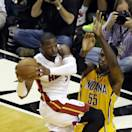 Miami Heat guard Dwyane Wade (3) looks to pass the ball as Indiana Pacers center Roy Hibbert (55) and forward Paul George (24) defend during the second half of Game 2 in their NBA basketball Eastern Conference finals playoff series, Friday, May 24, 2013, in Miami. (AP Photo/Alan Diaz)