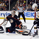 Anaheim Ducks goalie Frederik Andersen, center, stops the scoring attempt by Boston left wing Brad Marchand, right, during the third period of an NHL hockey game Monday, Dec. 1, 2014, in Anaheim, Calif The Associated Press