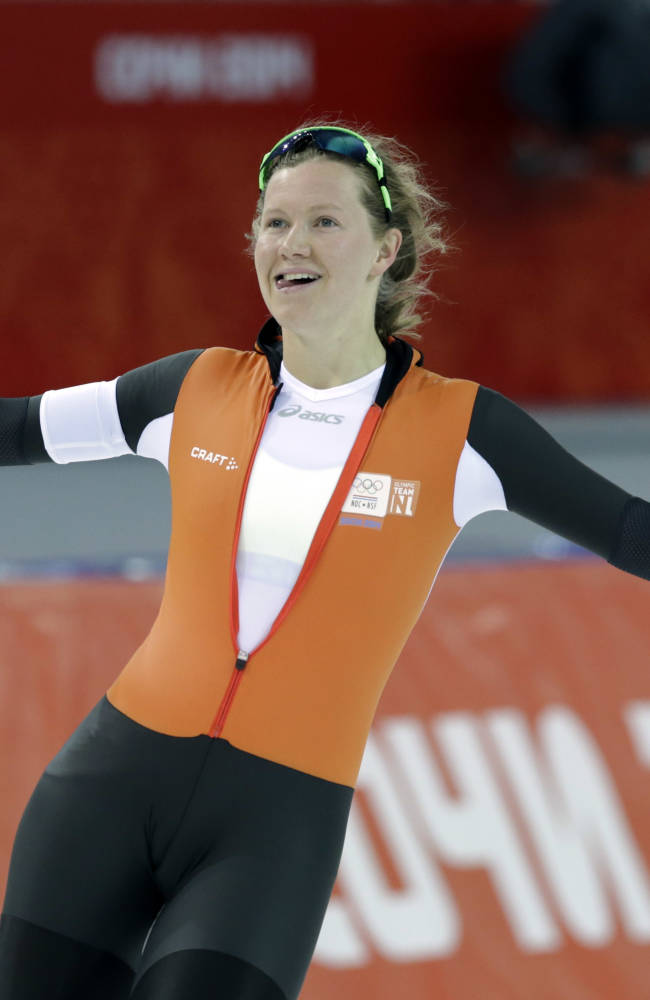 Lotte van Beek of the Netherlands celebrates after competing in the first heat of the women's 500-meter speedskating race at the Adler Arena Skating Center during the 2014 Winter Olympics, Tuesday, Feb. 11, 2014, in Sochi, Russia