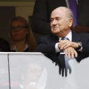 FIFA President Joseph Blatter waits for the beginning of the opening match between Brazil and Japan in group A of the soccer Confederations Cup at the National Stadium in Brasilia, Brazil, Saturday, June 15, 2013. (AP Photo/Eugene Hoshiko)