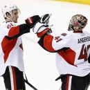Ottawa Senators' Mark Stone (61) congratulates Craig Anderson (41) on a win after the third period of an NHL hockey game against the Arizona Coyotes Saturday, Jan. 10, 2015, in Glendale, Ariz. The Senators defeated the Coyotes 5-1 The Associated Press