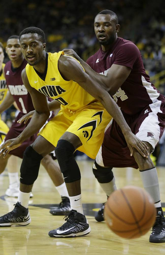 Iowa center Gabriel Olaseni, left, and Maryland-Eastern Shore center Francis Ezeiru eye a loose ball during the first half of an NCAA college basketball game, Thursday, Nov. 14, 2013, in Iowa City, Iowa