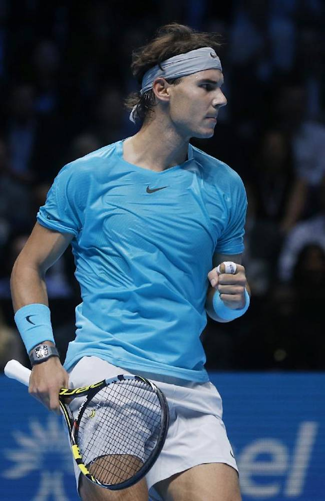 Rafael Nadal of Spain celebrates winning a point during the final of the ATP World Tour Finals singles tennis match against Novak Djokovic of Serbia at the O2 Arena in London Monday, Nov. 11, 2013