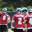 Philadelphia Eagles' Nick Foles (9) throws a pass while, Matt Barkley (2), G.J. Kinne (4) and Mark Sanchez wait during NFL football training camp on Sunday, July 27, 2014, in Philadelphia The Associated Press