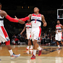 WASHINGTON, DC - MARCH 31: Bradley Beal #3 and John Wall #2 of the Washington Wizards celebrate during the game against the Toronto Raptors at the Verizon Center on March 31, 2013 in Washington, DC. (Photo by Ned Dishman/NBAE via Getty Images)
