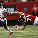 Chicago Bears running back Ka'Deem Carey (25) moves against Atlanta Falcons outside linebacker Kroy Biermann (71) during the first half of an NFL football game, Sunday, Oct. 12, 2014, in Atlanta The Associated Press
