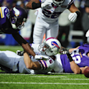 Minnesota Vikings outside linebacker Chad Greenway (52) and teammate Xavier Rhodes (29) fight for the ball fumbled by Buffalo Bills' Chris Hogan (15) during the first half of an NFL football game Sunday, Oct. 19, 2014, in Orchard Park, N.Y. The Vikings re