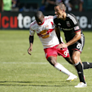 New York Red Bulls forward Bradley Wright-Phillips (99) goes after D.C. United midfielder Davy Arnaud (8) during the second half of an MLS soccer match, at RFK Stadium, Sunday, Aug. 31, 2014, in Washington. United won 2-0 The Associated Press