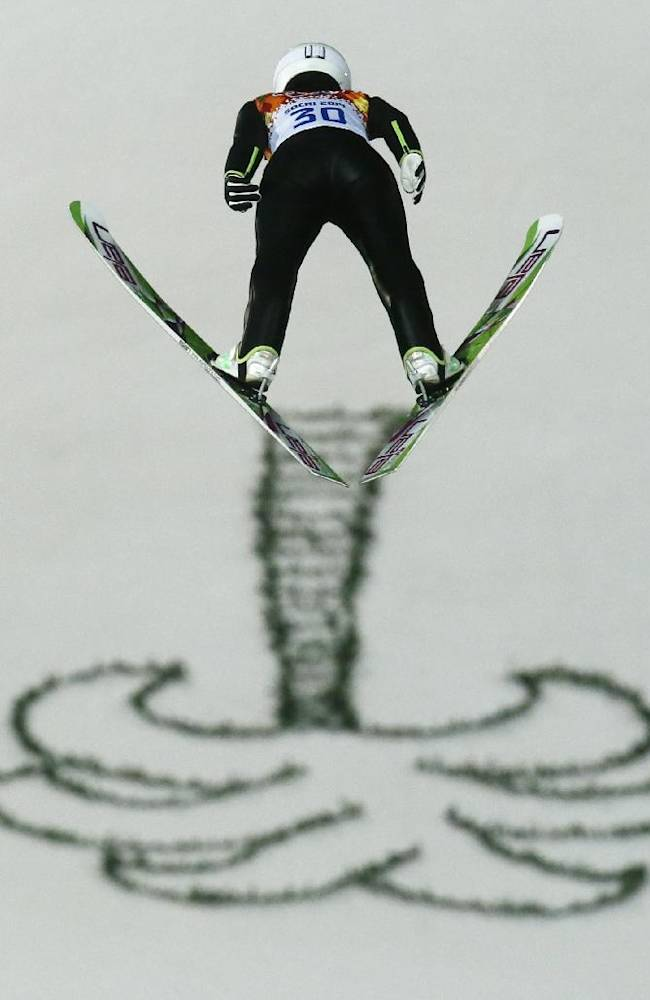 Japan's Sara Takanashi makes her first attempt during the women's normal hill ski jumping final at the 2014 Winter Olympics, Tuesday, Feb. 11, 2014, in Krasnaya Polyana, Russia