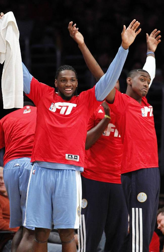 Denver Nuggets forward Kenneth Faried, left, and forward Quincy Miller, right celebrate a three-point shot during the second half of an NBA basketball game against the Los Angeles Lakers Sunday, Jan. 5, 2014, in Los Angeles. Nuggets won 137-115