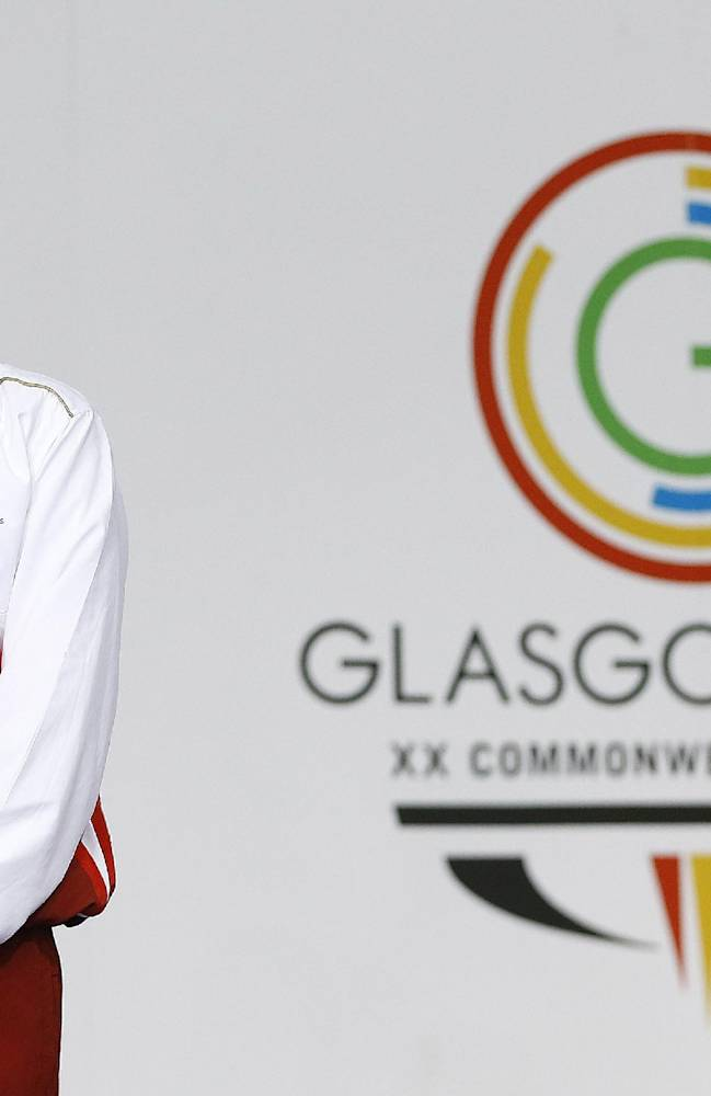 England's Francesca Halsall gestures after receiving the gold medal for winning the 50m freestyle swimming competition at the Tollcross International Swimming Centre during the Commonwealth Games 2014 in Glasgow, Scotland, Saturday July 26, 2014