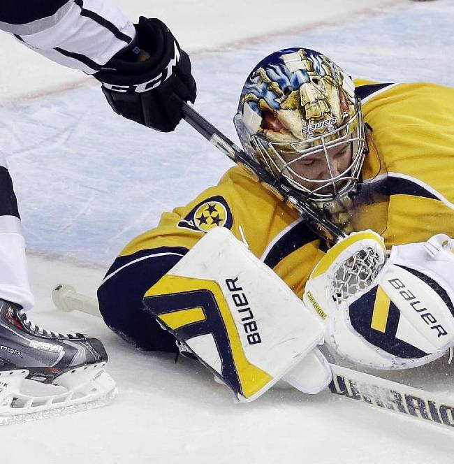 Nashville Predators goalie Pekka Rinne, of Finland, blocks a shot by Los Angeles Kings right wing Justin Williams, left, during the third period of an NHL hockey game Thursday, Oct. 17, 2013, in Nashville, Tenn. The Kings won 2-1 in a shootout