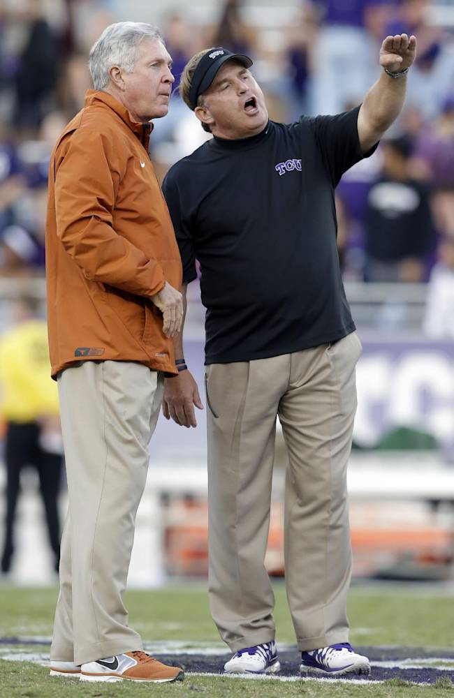 TCU head coach Gary Patterson, right, talks with Texas head coach Mack Brown, left, on the field during team warmups before an NCAA college football game on Saturday, Oct. 26, 2013, in Fort Worth, Texas