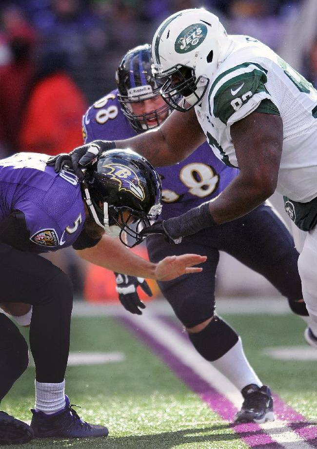 Baltimore Ravens quarterback Joe Flacco is sacked by New York Jets defensive end Kenrick Ellis during the first half of an NFL football game in Baltimore, Md., Sunday, Nov. 24, 2013