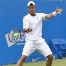 Lleyton Hewitt of Australia plays a return to Grigor Dimitrov of Bulgaria during their tennis match at the Queen's Club grass court championships in London, Wednesday, June 12, 2013. (AP Photo/Kirsty Wigglesworth)