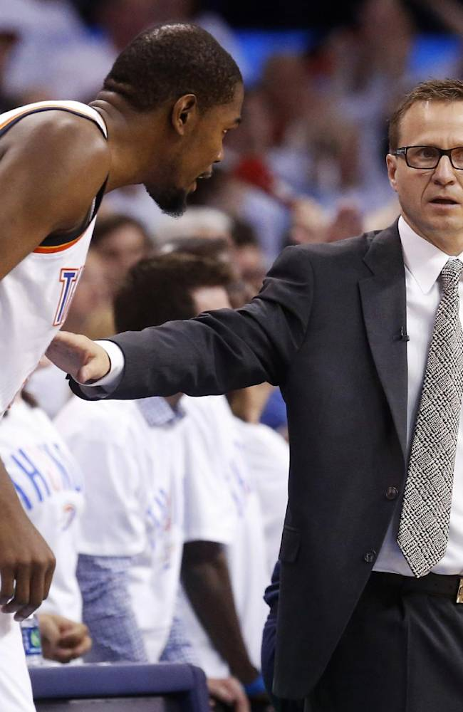 Oklahoma City Thunder head coach Scott Brooks talks with forward Kevin Durant in the second half of Game 5 of the Western Conference semifinal NBA basketball playoff series against the Los Angeles Clippers in Oklahoma City, Wednesday, May 14, 2014. Oklahoma City won 105-104. (AP Photo)