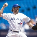Toronto Blue Jays starting pitcher R.A. Dickey works against the Tampa Bay Rays during first inning baseball action in Toronto on Monday, May 20, 2013. (AP Photo/The Canadian Press, Chris Young)