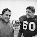 In this Nov. 20, 1964, file photo, Notre Dame coach Ara Parseghian, left, and team captain James Carroll are shown during a practice session in South Bend. Notre Dame was at rock bottom when Ara Parseghian took over 50 years ago. The Irish finished the se