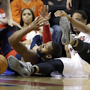 Detroit Pistons forward Greg Monroe, center, and Toronto Raptors guard DeMar DeRozan, right, go for the loose ball during the second half of an NBA basketball game in Auburn Hills, Mich., Sunday, April 13, 2014 The Associated Press