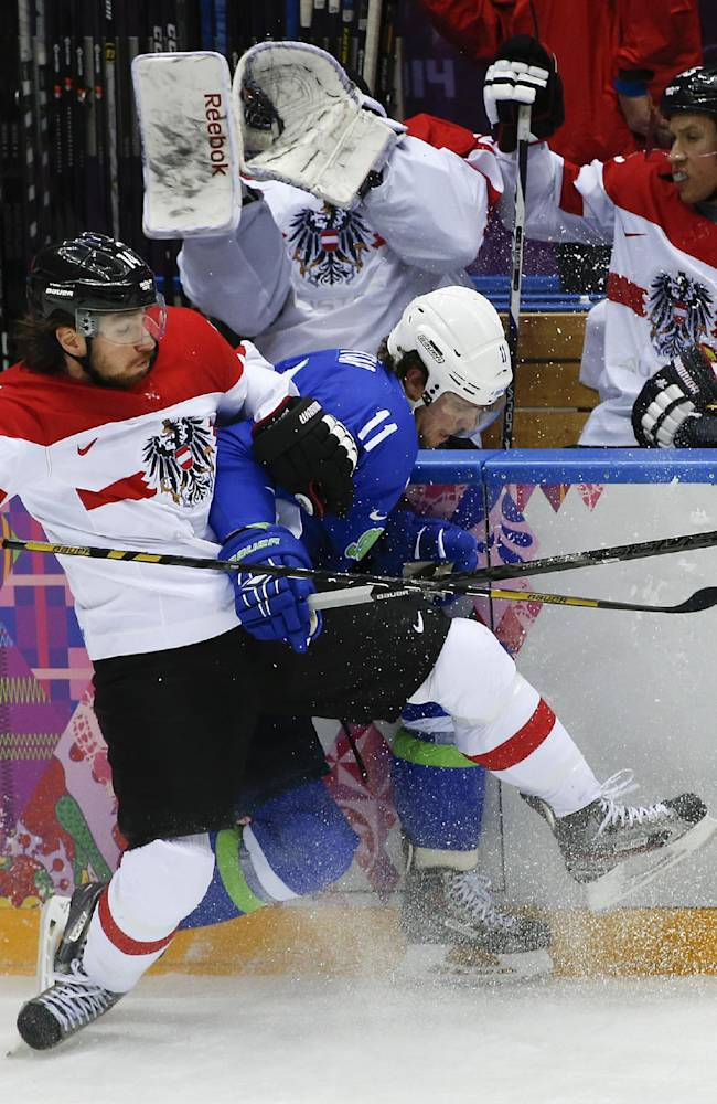 Austria forward Andreas Nodl collides with Slovenia forward Anze Kopitar in the first period of a men's ice hockey game at the 2014 Winter Olympics, Tuesday, Feb. 18, 2014, in Sochi, Russia