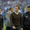 Rodolfo Arruabarrena, enters the field to lead his first match as head coach for Argentina's Boca Juniors, in Buenos Aires, Argentina, Sunday, Aug. 31, 2014. Arruabarrena became the new coach for Argentina's Boca Juniors, replacing fired coach Carlos Bian
