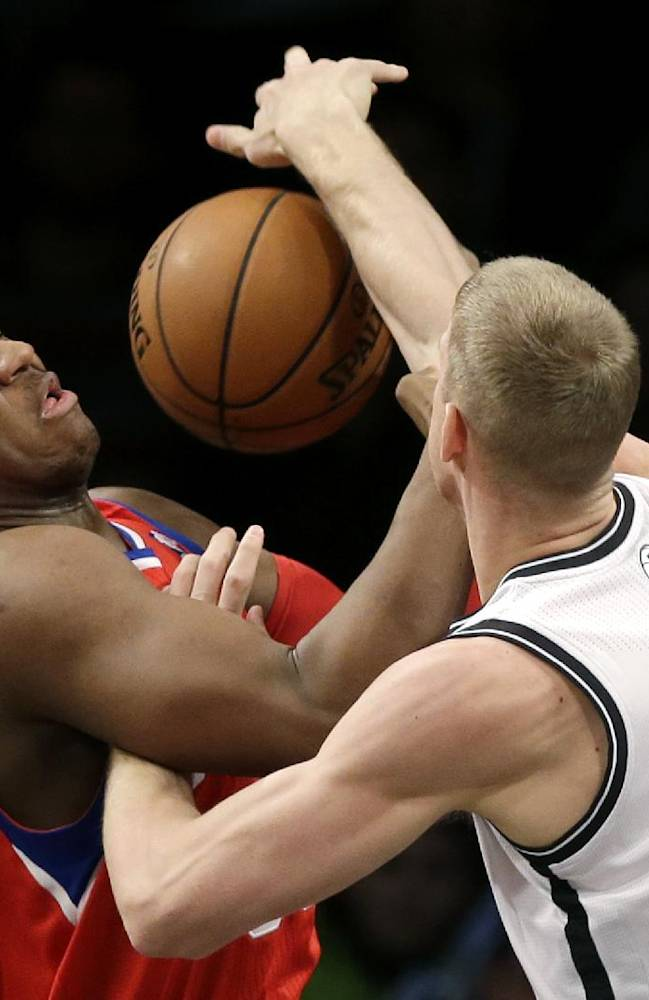 Philadelphia 76ers' Lavoy Allen, left, and Brooklyn Nets' Mason Plumlee fight for a rebound during the first half of an NBA basketball game at the Barclays Center, Monday, Dec. 16, 2013, in New York