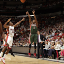MIAMI, FL - NOVEMBER 16: Brandon Knight #11 of the Milwaukee Bucks shoots the ball against the Miami Heat during the game on November 16, 2014 at AmericanAirlines Arena in Miami, Florida. (Photo by Issac Baldizon/NBAE via Getty Images)