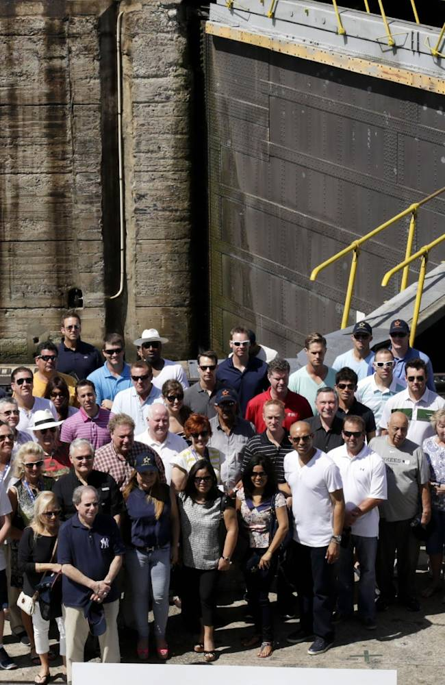 New York Yankees baseball player, staff members and companions pose for a photo during a visit to the Miraflores Locks at the Panama Canal in Panama City, Friday, March 14, 2014. The New York Yankees and the Miami Marlins will play on March 15-16, in the
