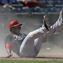 Cincinnati Reds' Chris Nelson scores looks for a call after scoring during the fifth inning of a spring exhibition baseball game against the Texas Rangers Monday, March 10, 2014, in Suprise, Ariz The Associated Press