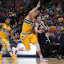 Utah Jazz guard Gordon Hayward, right, is fouled while driving by Denver Nuggets center Timofey Mozgov, center, of Russia, as guard Randy Foye trails the play in the fourth quarter of the Nuggets' 101-94 victory in an NBA basketball game in Denver on Satu