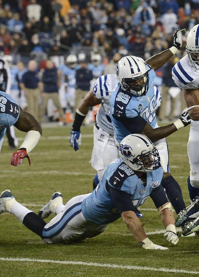 Indianapolis Colts running back Donald Brown (31) scores a touchdown on a 6-yard run against the Tennessee Titans in the third quarter of an NFL football game Thursday, Nov. 14, 2013, in Nashville, Tenn. Defending for the Titans are Zach Brown (55), Colin McCarthy (52) and Kamerion Wimbley (95)