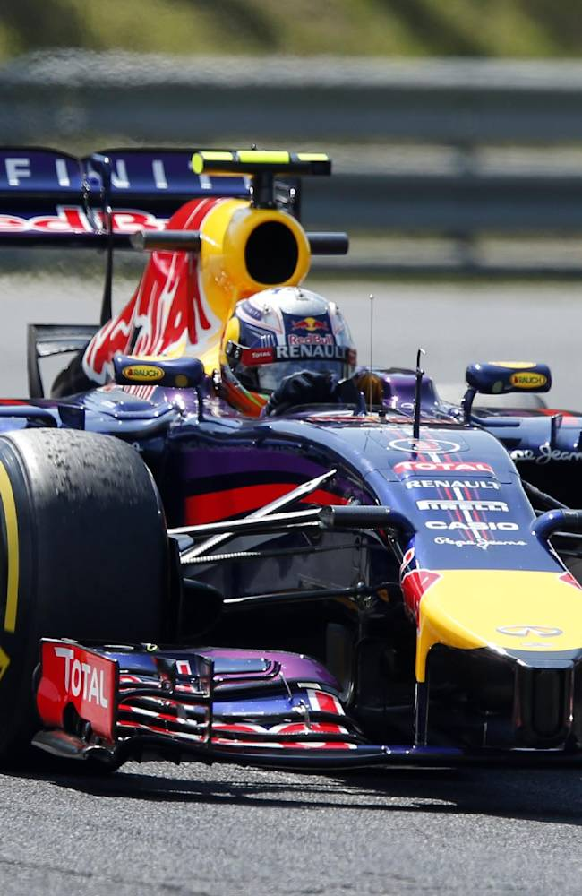 Red Bull driver Daniel Ricciardo of Australia steers his car during the free practice session at the Hungarian Formula One Grand Prix in Budapest, Hungary, Friday, July 25, 2014. The Hungarian Formula One Grand Prix will be held on Sunday, July, 27, 2014
