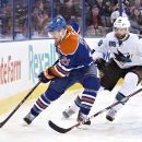 San Jose Sharks Brent Burns (88) chases Edmonton Oilers Andrew Ference (21) during first period NHL hockey action in Edmonton, Alberta, on Tuesday March 25, 2014 The Associated Press