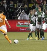 A group of Portland Timbers players brace themselves as Houston Dynamo midfielder Adam Moffat takes a penalty kick during the first half of an MLS soccer game in Portland, Ore., Saturday, April 6, 2013. (AP Photo/Don Ryan)