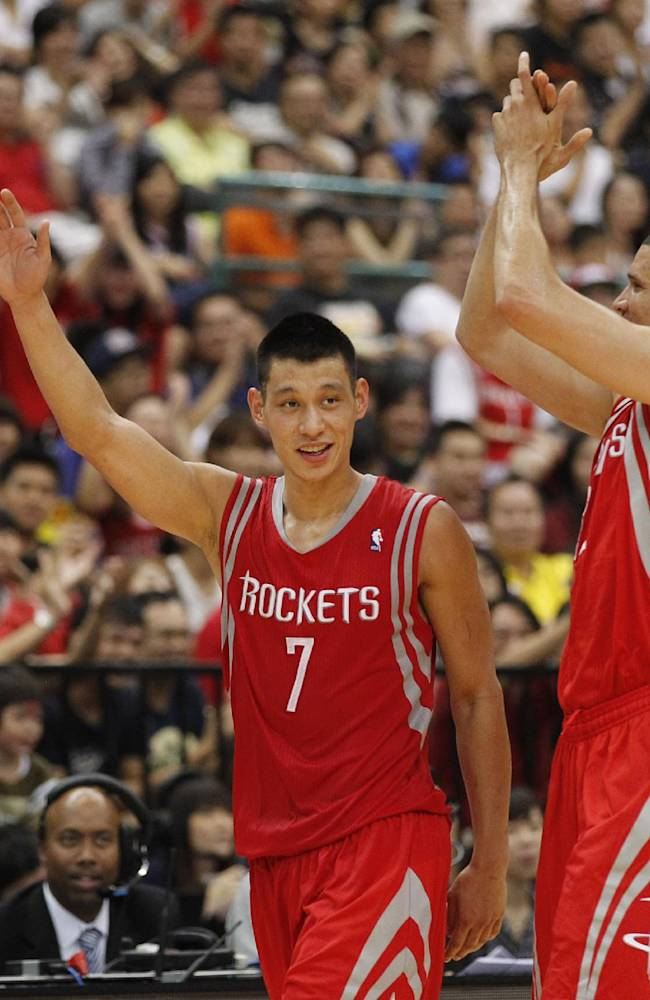 Houston Rockets Jeremy Lin (7) cheers with Francisco Garcia after scoring against the Indiana Pacers during a preseason game in Taipei, Taiwan, Sunday, Oct. 13, 2013. The Rockets beat the Pacers 107-98