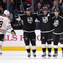 Los Angeles Kings right wing Marian Gaborik, second from left, of Slovakia, celebrates a goal by defenseman Jake Muzzin with teammates center Anze Kopitar, second from right, of Slovenia, and defenseman Drew Doughty, right, as Chicago Blackhawks center Jo