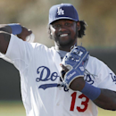 Los Angeles Dodgers shortstop Hanley Ramirez throws during spring training baseball practice in Glendale, Ariz., Friday, Feb. 14, 2014 The Associated Press