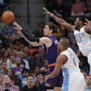 Phoenix Suns guard Goran Dragic, left, of Slovenia, passes ball as Denver Nuggets guard Randy Foye, front right, and forward Kenneth Faried cover in the third quarter of the Suns' 112-107 overtime victory in an NBA basketball game in Denver on Tuesday, Fe