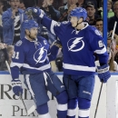 Tampa Bay Lightning center Steven Stamkos (91) celebrates with teammate defenseman Andrej Sustr (62), of the Czech Republic, after scoring against the Edmonton Oilers during the second period of an NHL hockey game Thursday, Jan. 15, 2015, in Tampa, Fla Th