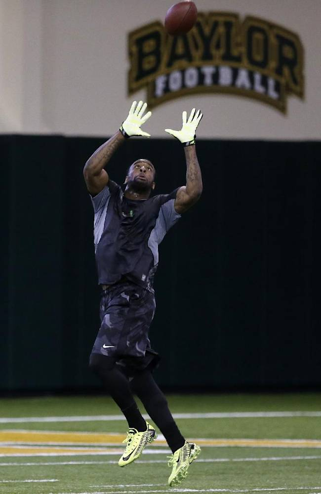 Baylor defensive back Ahmad Dixon reaches up to grab a pass during pro day for NFL football representatives on Wednesday, March 19, 2014, in Waco, Texas