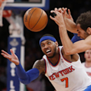 New York Knicks' Carmelo Anthony (7) fights for possession against Dallas Mavericks' Jose Calderon during the first half of an NBA basketball game, Monday, Feb. 24, 2014, in New York The Associated Press