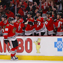 Chicago Blackhawks right wing Patrick Kane (88) celebrates with teammates after scoring a goal against the Dallas Stars during the first period of an NHL hockey game, Sunday, Jan. 18, 2015, in Chicago The Associated Press