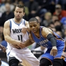 Minnesota Timberwolves' J.J. Barea, left, knocks the ball away from Oklahoma City Thunder's Russell Westbrook in the first quarter of an NBA basketball game on Friday, March 29, 2013, in Minneapolis. (AP Photo/Jim Mone)