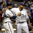 Milwaukee Brewers' Francisco Rodriguez (57) and catcher Jonathan Lucroy celebrate after a baseball game against the San Diego Padres, Wednesday, April 23, 2014, in Milwaukee. The Brewers won 5-2 The Associated Press