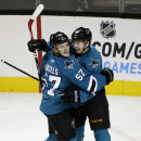 San Jose Sharks' Tomas Hertl, right, of the Czech Republic, celebrates his goal with teammate Tommy Wingels (57) during the first period of an NHL hockey game against the New York Islanders Saturday, Nov. 1, 2014, in San Jose, Calif The Associated Press